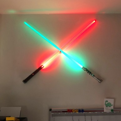 Support crossed two lightsabers to X to the wall.